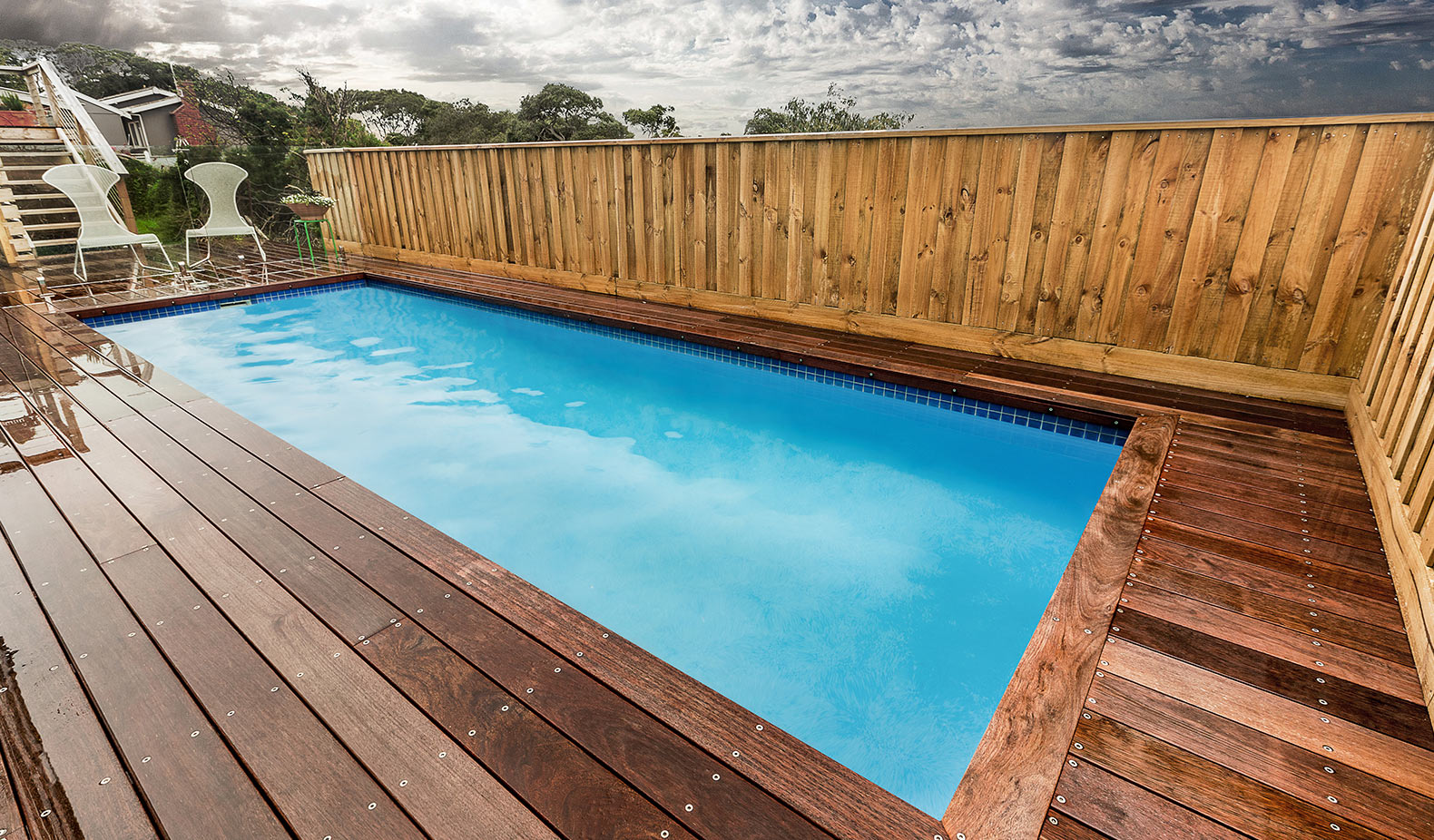 landscaping sloping block with swimming pool